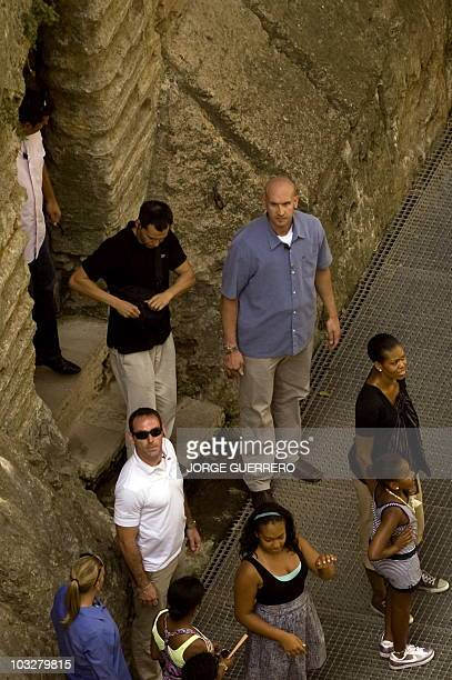 US First Lady Michelle Obama and her daughter Sasha visit he 'Casa del Rey Moro' in the Spanish southern city of Ronda on August 7 2010 during her...