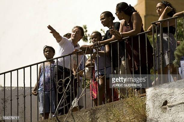US First Lady Michelle Obama and her daughter Sasha visit the 'Casa del Rey Moro' in the Spanish southern city of Ronda on August 7 2010 during her...
