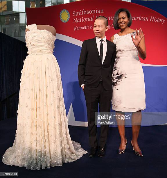 First lady Michelle Obama and inaugural dress designer Jason Wu look at the inaugural gown she wore to the inaugural balls and is now on display at...