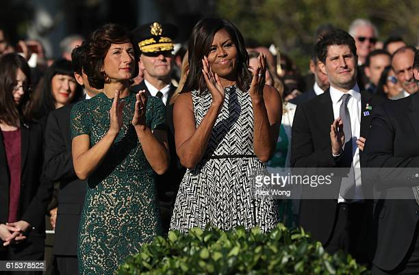US first lady Michelle Obama and Italian first lady Agnese Landini participate in an official arrival ceremony on the South Lawn of the White House...