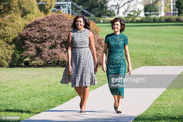 First Lady Michelle Obama and Mrs Agnese Landini make their way out to the White House Kitchen Garden on the South Lawn in Washington DC USA on...