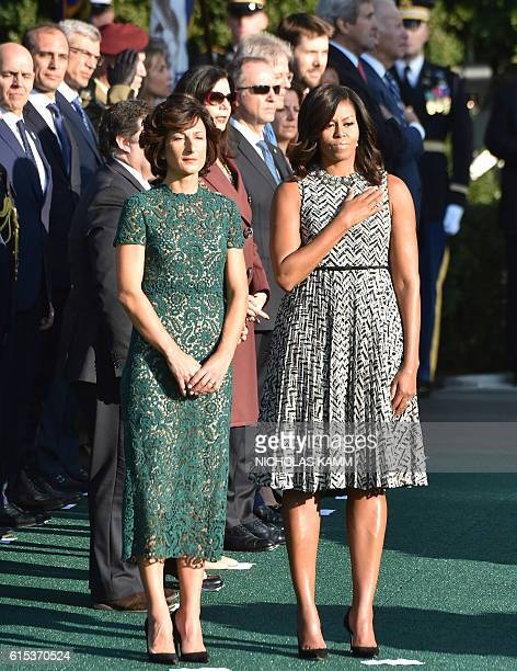 US First Lady Michelle Obama and Mrs Agnese Landini stand during the welcome ceremony for Prime Minister Matteo Renzi during a state visit on October...