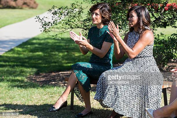 US First Lady Michelle Obama and Mrs Agnese Landini wife of Italian Prime Minister Matteo Renzi attend a performance by students from Savoy...