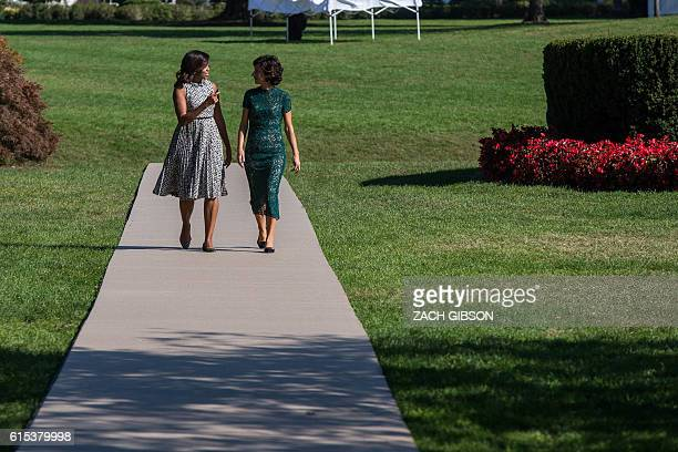 US First Lady Michelle Obama and Mrs Agnese Landini wife of Italian Prime Minister Matteo Renzi cross the South Lawn to attend a performance by...