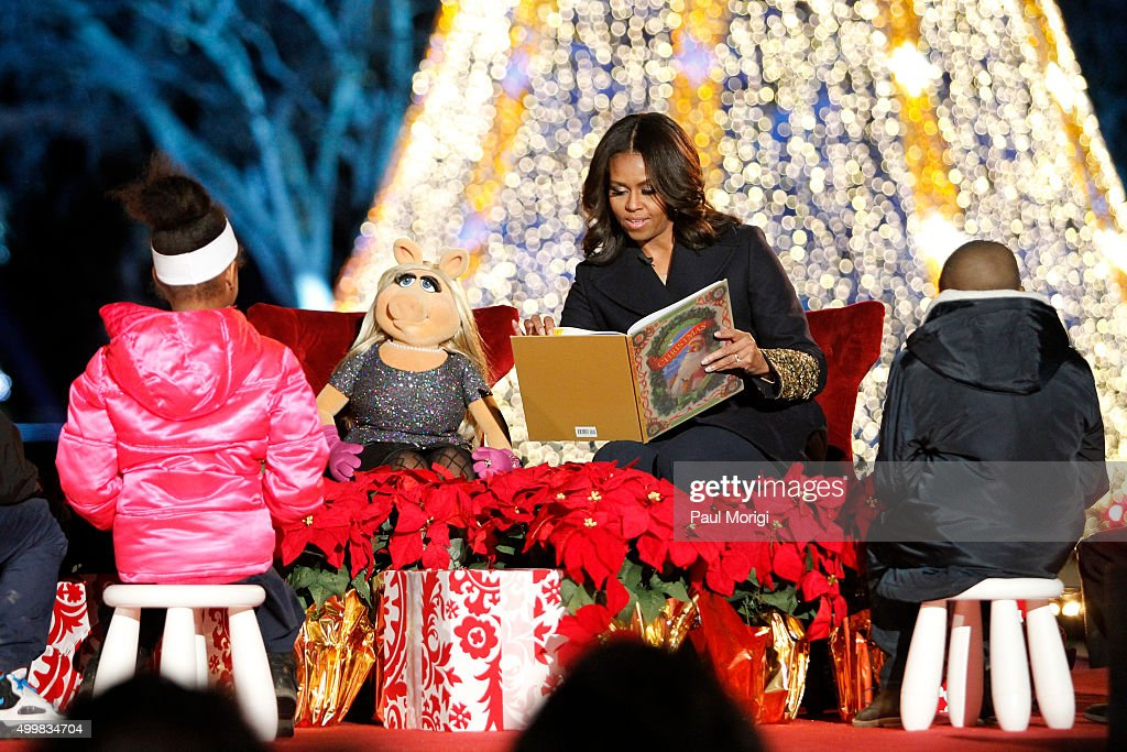 First Lady Michelle Obama and Muppet Miss Piggy read 'Twas the Night Before Christmas' to children at the 93rd Annual National Christmas Tree Lighting at The Ellipse on December 3, 2015 in Washington, DC.