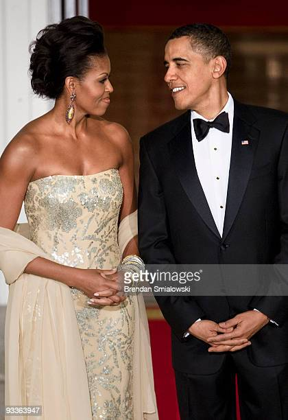 First lady Michelle Obama and President Barack Obama await the arrival of the Indian Prime Minister at the North Portico of the White House November...