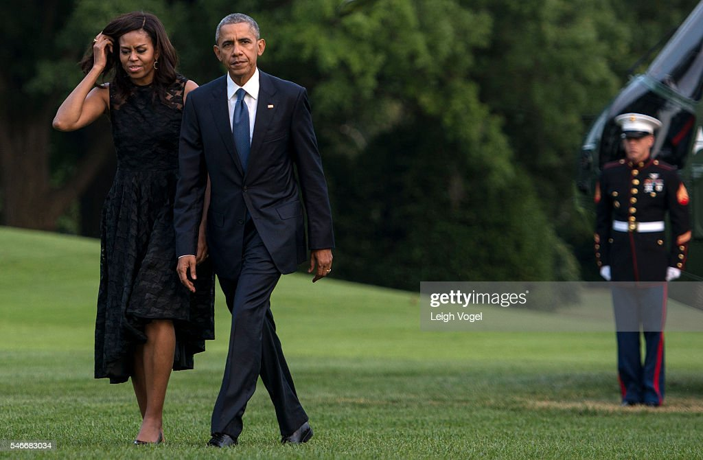 First Lady Michelle Obama and President Barack Obama depart Marine One after visiting Dallas Texas where the President delivered remarks at an...