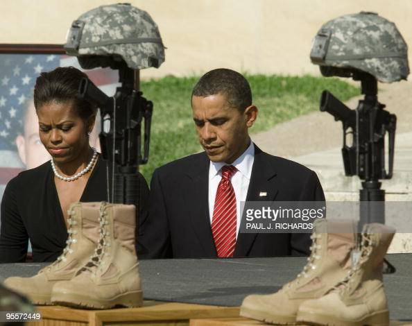 US First Lady Michelle Obama and President Obama walk past the Fallen Hero Memorial at Fort Hood on November 10 2009 during a service honoring the...