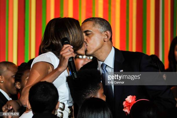 First Lady Michelle Obama and President of the United States Barack Obama speak during the White House Talent Show at the White House on May 20 2014...