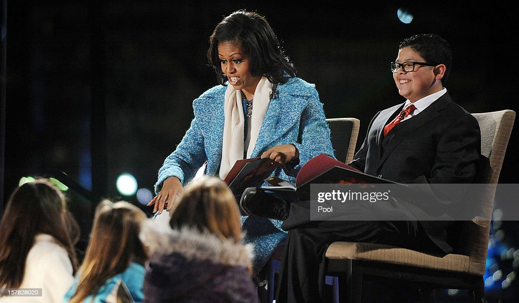 First lady Michelle Obama and Rico Rodriguez, actor on Modern Family read a story to kids during the 90th National Christmas Tree Lighting Ceremony on the Ellipse behind the White House on December 6, 2012 in Washington, DC. This year is the 90th annual National Christmas Tree Lighting Ceremony.
