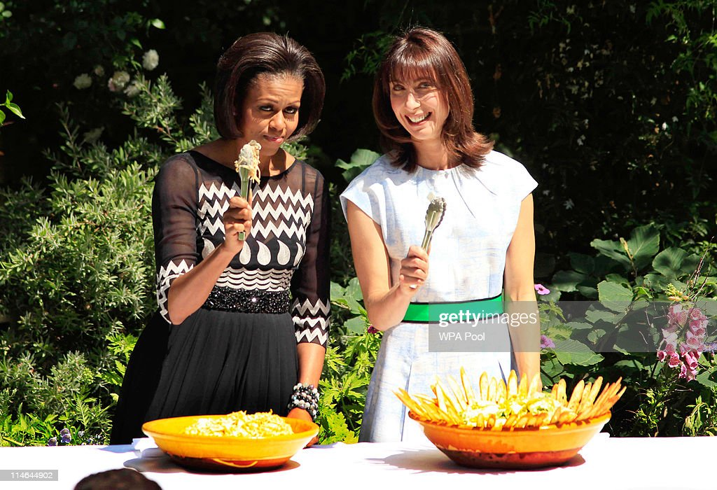 US first lady <a gi-track='captionPersonalityLinkClicked' href=/galleries/search?phrase=Michelle+Obama&family=editorial&specificpeople=2528864 ng-click='$event.stopPropagation()'>Michelle Obama</a> (L) and <a gi-track='captionPersonalityLinkClicked' href=/galleries/search?phrase=Samantha+Cameron&family=editorial&specificpeople=624344 ng-click='$event.stopPropagation()'>Samantha Cameron</a>, wife of Britain's Prime Minister David Cameron pose while serving food to members of the military during a barbecue in the garden of 10 Downing Street on May 25, 2011 in London, England. The 44th President of the United States, Barack Obama, and his wife Michelle are in the UK for a two day State Visit at the invitation of HM Queen Elizabeth II. Last night they attended a state banquet at Buckingham Palace and today's events include talks at Downing Street and the President will address both houses of parliament at Westminster Hall.