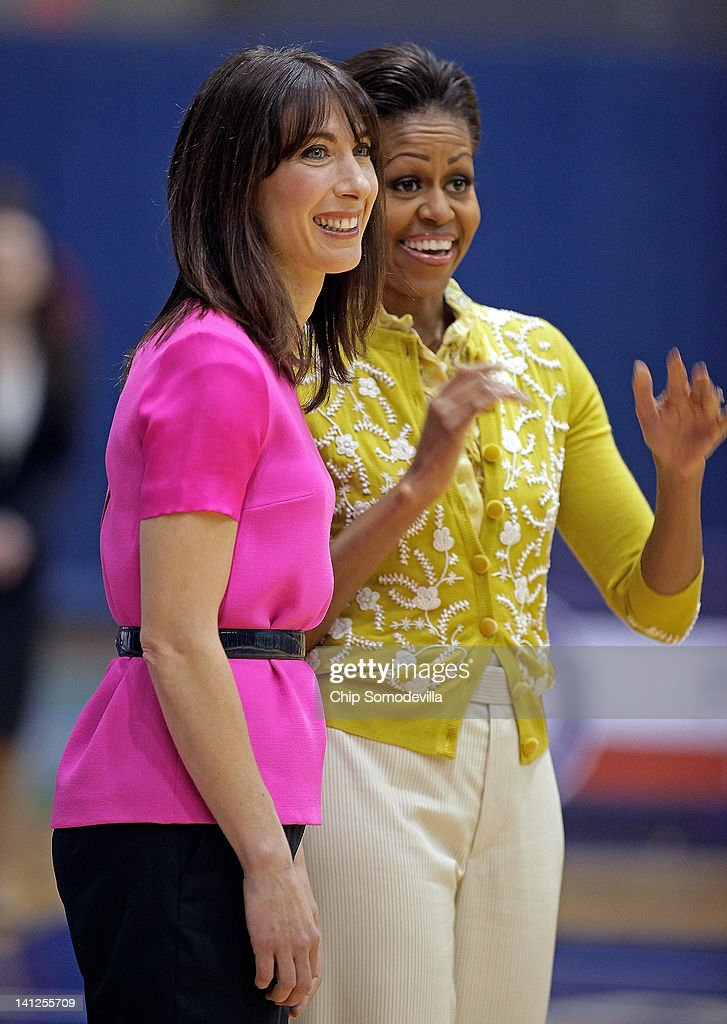 U.S. First Lady <a gi-track='captionPersonalityLinkClicked' href=/galleries/search?phrase=Michelle+Obama&family=editorial&specificpeople=2528864 ng-click='$event.stopPropagation()'>Michelle Obama</a> (R) and <a gi-track='captionPersonalityLinkClicked' href=/galleries/search?phrase=Samantha+Cameron&family=editorial&specificpeople=624344 ng-click='$event.stopPropagation()'>Samantha Cameron</a>, wife of British Prime Minister David Cameron, participate in an Olympics-themed event with area school children at American University March 13, 2012 in Washington, DC. Fifth graders from MacFarland Middle School in Washington, D.C., Manor View Elementary School in Maryland and Arlington Science Focus School in Virginia participated in a mini-Olympics competition in celebration of the 2012 London Summer Olympics and the first lady's Let's Move! initiative.