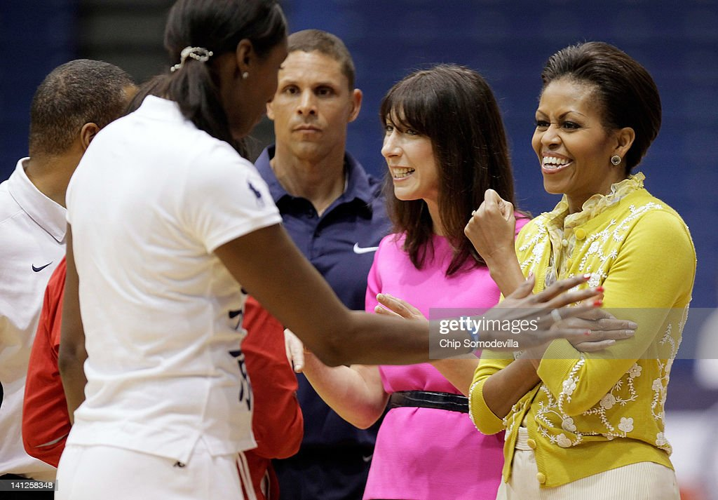 First Lady <a gi-track='captionPersonalityLinkClicked' href=/galleries/search?phrase=Michelle+Obama&family=editorial&specificpeople=2528864 ng-click='$event.stopPropagation()'>Michelle Obama</a> (R) and <a gi-track='captionPersonalityLinkClicked' href=/galleries/search?phrase=Samantha+Cameron&family=editorial&specificpeople=624344 ng-click='$event.stopPropagation()'>Samantha Cameron</a> (2nd R), wife of British Prime Minister David Cameron, visit with American decathlete and Olympic gold-medal winner Dan O'Brien (C) and WNBA MVP and a four-time Olympic gold medal winner <a gi-track='captionPersonalityLinkClicked' href=/galleries/search?phrase=Lisa+Leslie&family=editorial&specificpeople=202228 ng-click='$event.stopPropagation()'>Lisa Leslie</a> (2nd L) during an Olympics-themed event with area school children at American University March 13, 2012 in Washington, DC. Fifth graders from MacFarland Middle School in Washington, D.C., Manor View Elementary School in Maryland and Arlington Science Focus School in Virginia participated in a mini-Olympics competition in celebration of the 2012 London Summer Olympics and the first lady's Let's Move! initiative.