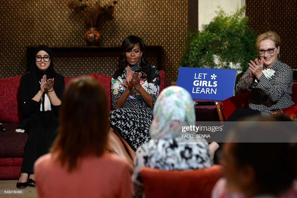 US first lady Michelle Obama (C) and US actress Meryl Streep (R) applaud as they meet with Moroccan young women following the 'Let Girls Learn' Program on June 28, 2016 in the Western Moroccan city of Marrakesh. US First Lady Michelle Obama began a two day visit to Morocco to participate in a CNN-moderated conversation with adolescent girls on the challenges they face in getting a quality education. / AFP / FADEL