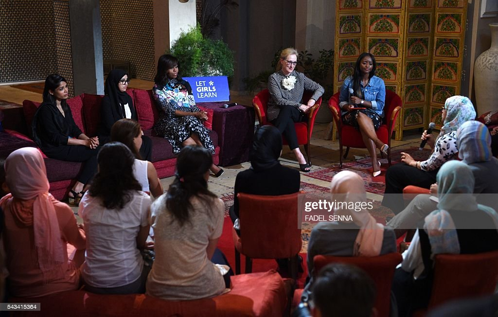 US first lady Michelle Obama (3rdL) and US actress Meryl Streep (2ndR) meet with Moroccan young women following the 'Let Girls Learn' Program on June 28, 2016 in the Western Moroccan city of Marrakesh. US First Lady Michelle Obama began a two day visit to Morocco to participate in a CNN-moderated conversation with adolescent girls on the challenges they face in getting a quality education. / AFP / FADEL