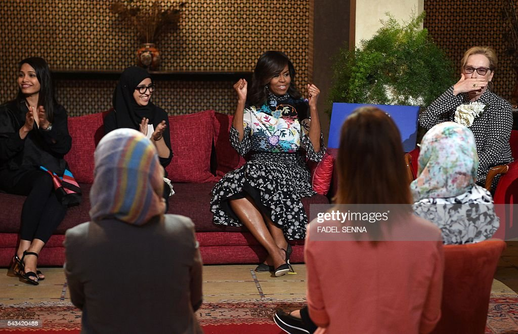 US first lady Michelle Obama (C) and US actress Meryl Streep (R) meet with Moroccan young women following the 'Let Girls Learn' Program on June 28, 2016 in the Western Moroccan city of Marrakesh. US First Lady Michelle Obama began a two day visit to Morocco to participate in a CNN-moderated conversation with adolescent girls on the challenges they face in getting a quality education. / AFP / FADEL