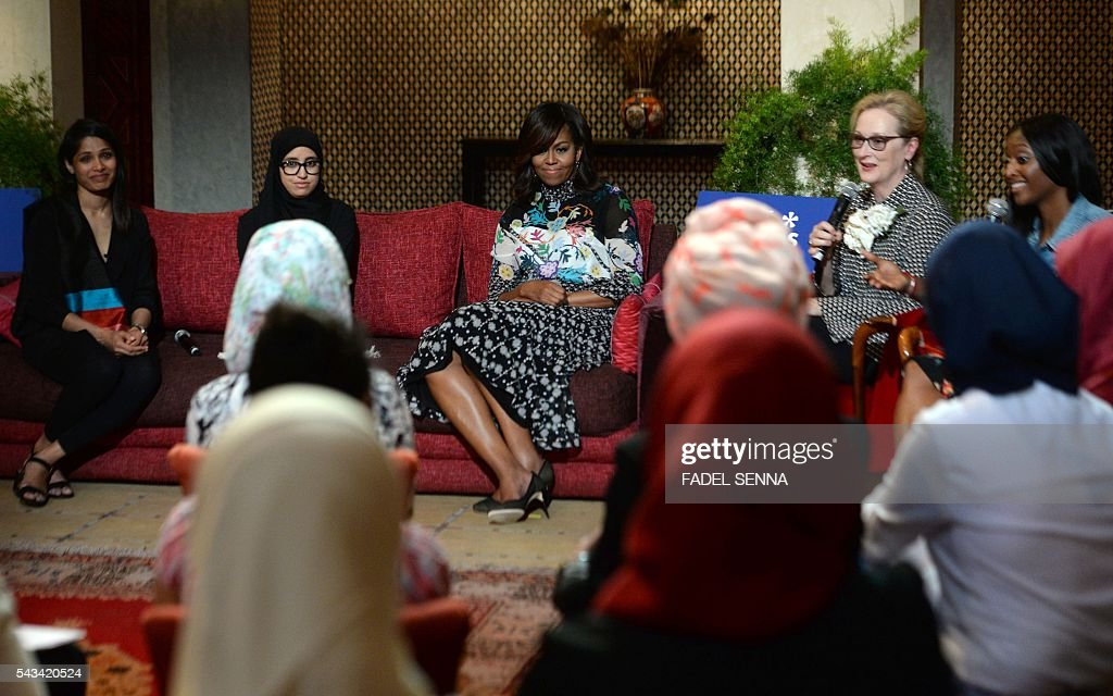 US first lady Michelle Obama (C) and US actress Meryl Streep (2ndR) meet with Moroccan young women following the 'Let Girls Learn' Program on June 28, 2016 in the Western Moroccan city of Marrakesh. US First Lady Michelle Obama began a two day visit to Morocco to participate in a CNN-moderated conversation with adolescent girls on the challenges they face in getting a quality education. / AFP / FADEL