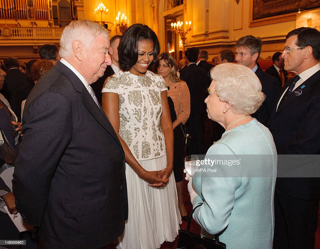 US First Lady <a gi-track='captionPersonalityLinkClicked' href=/galleries/search?phrase=Michelle+Obama&family=editorial&specificpeople=2528864 ng-click='$event.stopPropagation()'>Michelle Obama</a> and US Ambassador Louis Susman (L) meets Queen <a gi-track='captionPersonalityLinkClicked' href=/galleries/search?phrase=Elizabeth+II&family=editorial&specificpeople=67226 ng-click='$event.stopPropagation()'>Elizabeth II</a> and US Ambassador Louis Susman during a reception at Buckingham Palace a reception for Heads of State and Government attending the Olympics Opening Ceremony on July 27, 2012 in London, England.