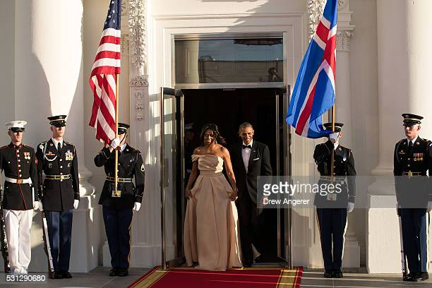 First lady Michelle Obama and US President Barack Obama arrive to greet leaders arriving for the Nordic state dinner on the North Portico at the...
