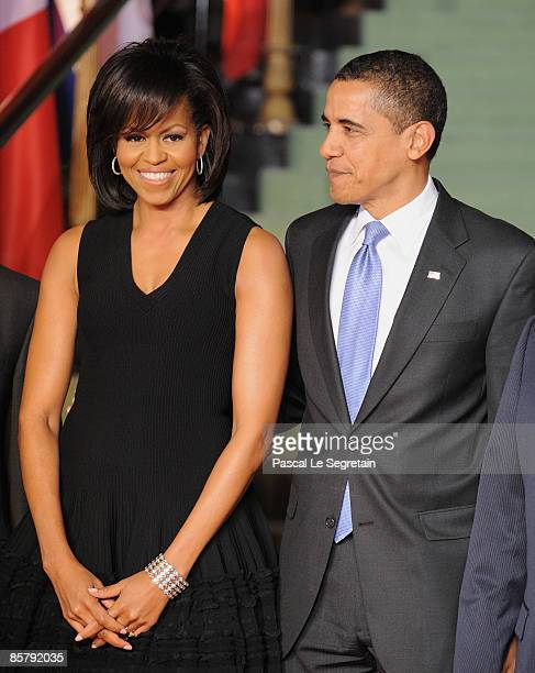 First Lady Michelle Obama and US President Barack Obama pose as they arrive to attend the opening of the NATO summit at the Kurhaus on April 3 2009...