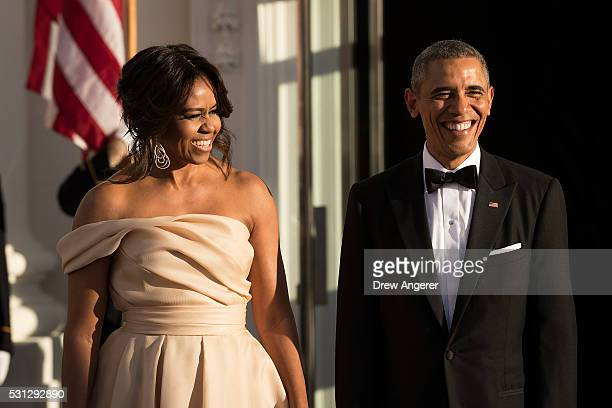 First Lady Michelle Obama and US President Barack Obama wait for leaders to arrive for the Nordic state dinner on the North Portico at the White...