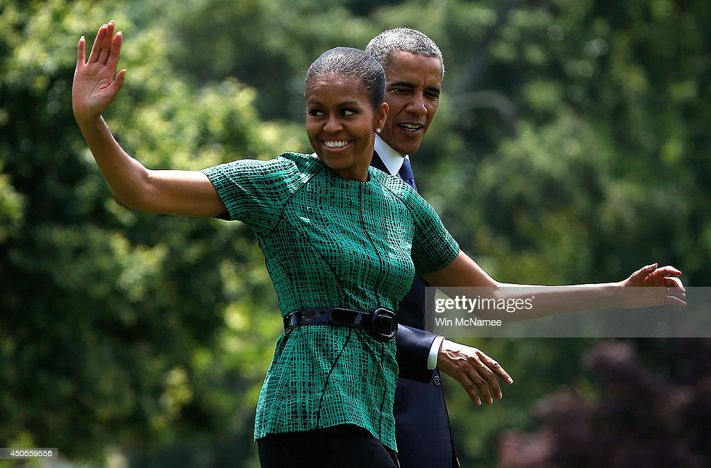 First lady <a gi-track='captionPersonalityLinkClicked' href=/galleries/search?phrase=Michelle+Obama&family=editorial&specificpeople=2528864 ng-click='$event.stopPropagation()'>Michelle Obama</a> and U.S. President <a gi-track='captionPersonalityLinkClicked' href=/galleries/search?phrase=Barack+Obama&family=editorial&specificpeople=203260 ng-click='$event.stopPropagation()'>Barack Obama</a> wave to spectators watching his departure after he made a statement on the situation in Iraq from the south lawn of the White House June 13, 2014 in Washington, DC. Obama said he will make a decision in the 'days ahead' about the use of American military power to aid the Iraqi government in its battle against Islamic insurgents.