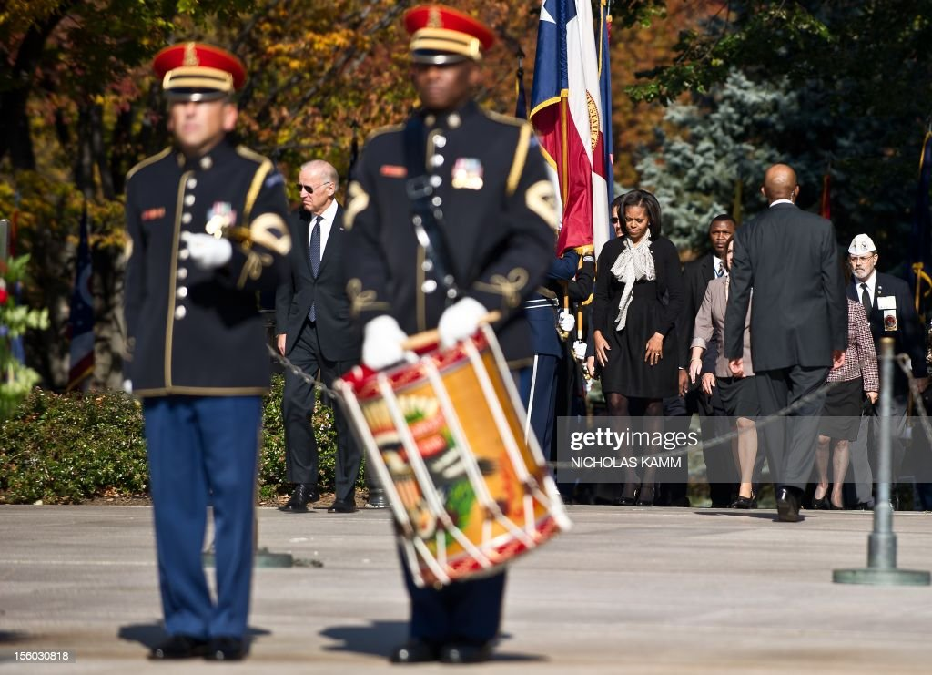 US First Lady Michelle Obama and Vice President Joe Biden arrive for a wreath-laying ceremony for Veterans' Day attended by US President Barack Obama at Arlington National Cemetery in Arlington, Virginia, on November 11, 2012. AFP PHOTO/Nicholas KAMM