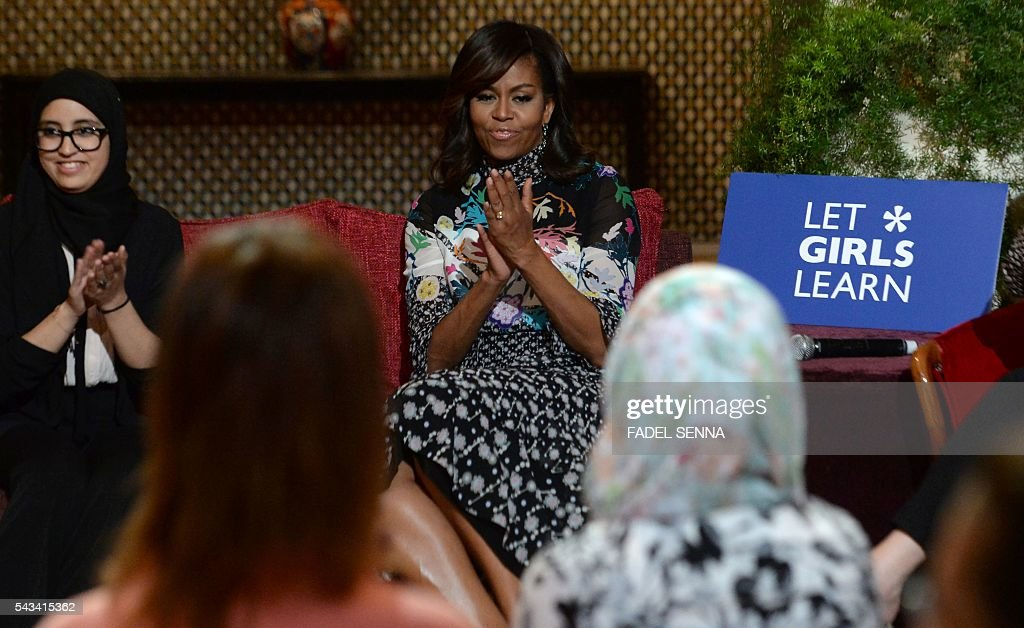 US first lady Michelle Obama (C) applauds as she meets with Moroccan young women following the 'Let Girls Learn' Program on June 28, 2016 in the Western Moroccan city of Marrakesh. US First Lady Michelle Obama began a two day visit to Morocco to participate in a CNN-moderated conversation with adolescent girls on the challenges they face in getting a quality education. / AFP / FADEL