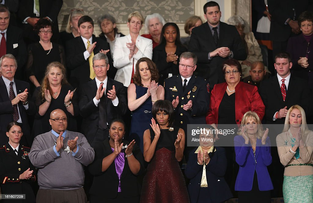 U.S. first lady Michelle Obama applauds as U.S. President Barack Obama delivers his State of the Union speech at the U.S. Capitol February 13, 2013 in Washington, DC. Facing a divided Congress, Obama concentrated his speech on new initiatives designed to stimulate the U.S. economy and said, 'It's not a bigger government we need, but a smarter government that sets priorities and invests in broad-based growth'.