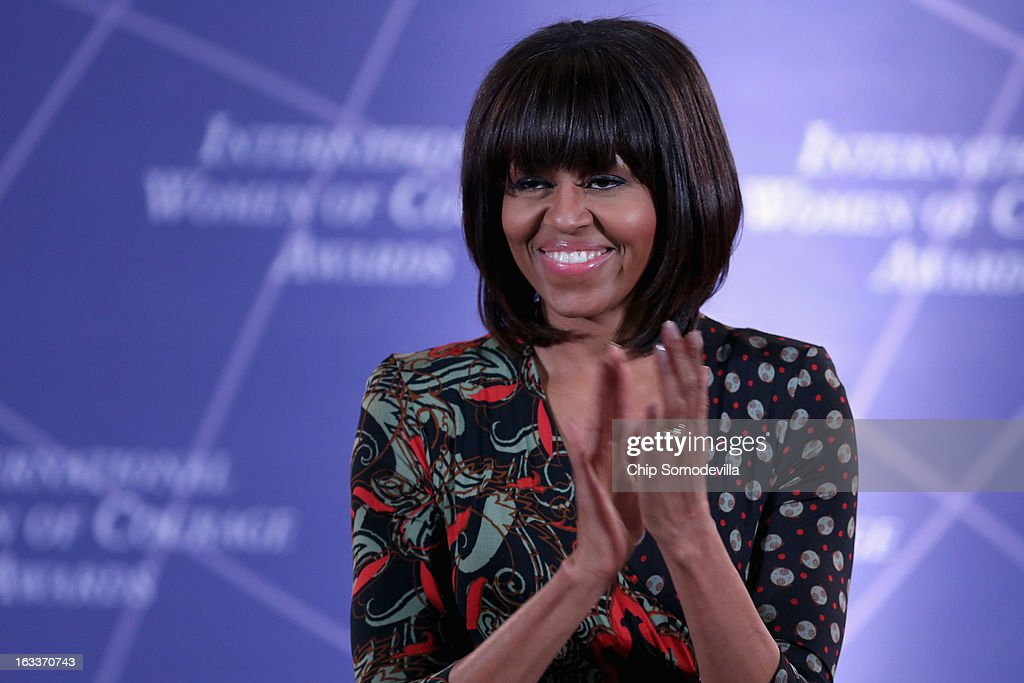 U.S. first lady Michelle Obama applauds while delivering remarks at the International Women of Courage Awards Ceremony at the State Department March 8, 2013 in Washington, DC. In celebration of the 102nd International Women's Day, the State Department honored nine women from around the world with the International Women of Courage Award, including the 23-year-old Indian woman known only as 'Nirbhaya,' who died from injuries she received after being gang raped by six men last December in Delhi.