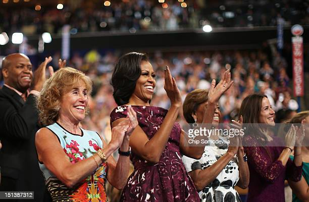 First lady Michelle Obama applauds with her mother Marian Robinson during the final day of the Democratic National Convention at Time Warner Cable...