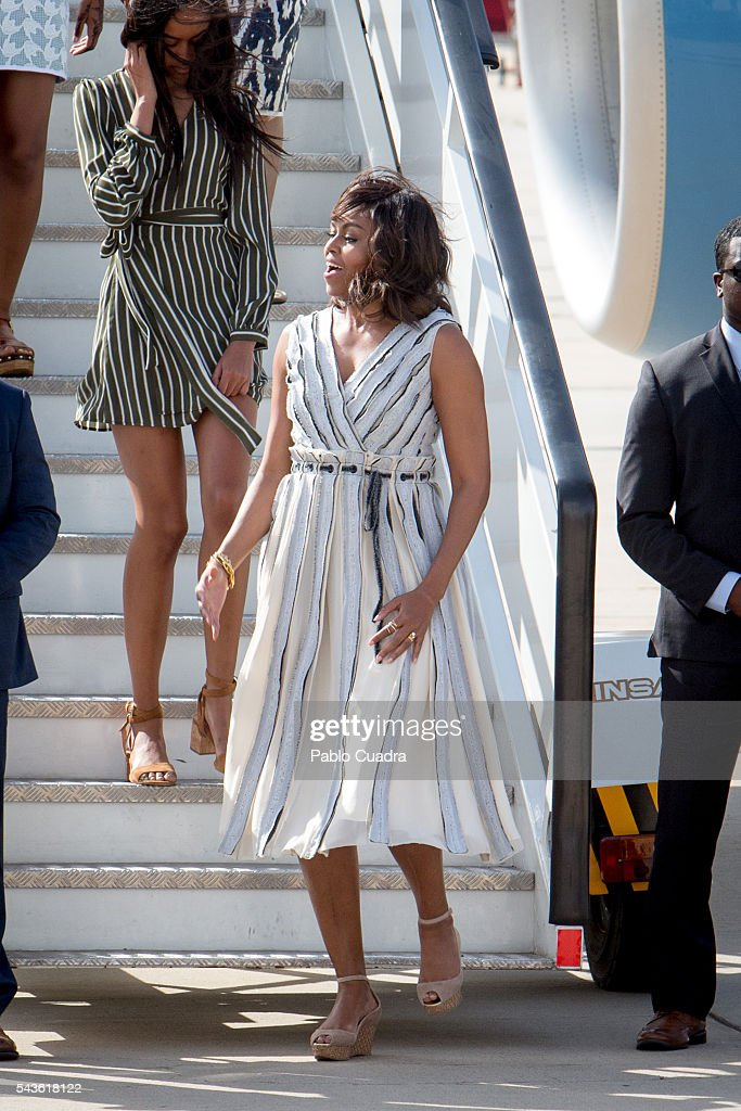 US First Lady <a gi-track='captionPersonalityLinkClicked' href=/galleries/search?phrase=Michelle+Obama&family=editorial&specificpeople=2528864 ng-click='$event.stopPropagation()'>Michelle Obama</a> arrives at Torrejon Air Force Base on June 29, 2016 in Madrid. The First Lady will deliver a speech on Let Girls Learn to girls and young women, sharing the stories of girls she has met in her prior travels and highlighting new commitments to support Let Girls Learn. Mrs. Obama will encourage the audience to value their own educational opportunities, continue to strive for progress for girls and young women in their country, and take action to help the more than 62 million girls around the world who are out of school, 2016 in Madrid, Spain.