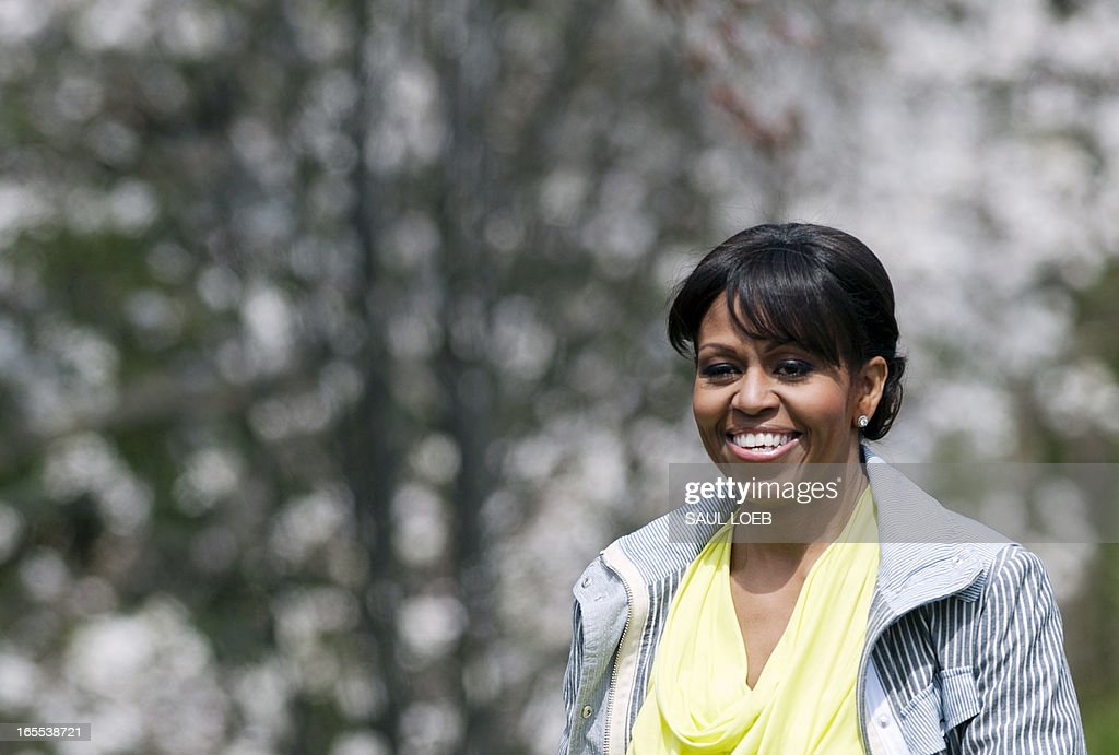 US First Lady Michelle Obama arrives to help students plant vegetables in the White House Kitchen Garden on the South Lawn of the White House in Washington, DC, April 4, 2013. In what has become an annual event, Obama invites students from schools that have made large improvements in their school lunch programs, including schools from Florida, Massachusetts, Tennessee and Vermont. AFP PHOTO / Saul LOEB