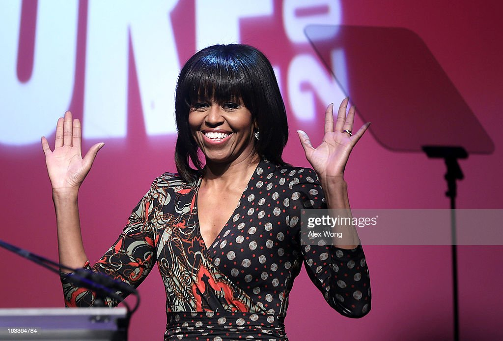 U.S. first lady <a gi-track='captionPersonalityLinkClicked' href=/galleries/search?phrase=Michelle+Obama&family=editorial&specificpeople=2528864 ng-click='$event.stopPropagation()'>Michelle Obama</a> arrives to speak during the 'Building a Healthier Future Summit' March 8, 2013 at the Lisner Auditorium of George Washington University in Washington, DC. The first lady spoke on ensuring the health of the nation's youths and childhood obesity.