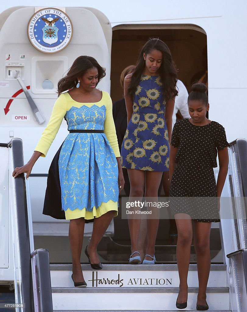 First Lady Michelle Obama arrives with daughters Malia Obama (C) and Sasha Obama (R) at Stanstead airport on June 15, 2015 in London, England. The First Lady is travelling to London with her daughters, Malia and Sasha and her mother, Mrs. Marian Robinson, to continue a global tour promoting her Let Girls Learn Initiative.  During the visit she will meet with students at a girl's school to discuss how the UK and U.S. are working together to expand girl's education around the world.