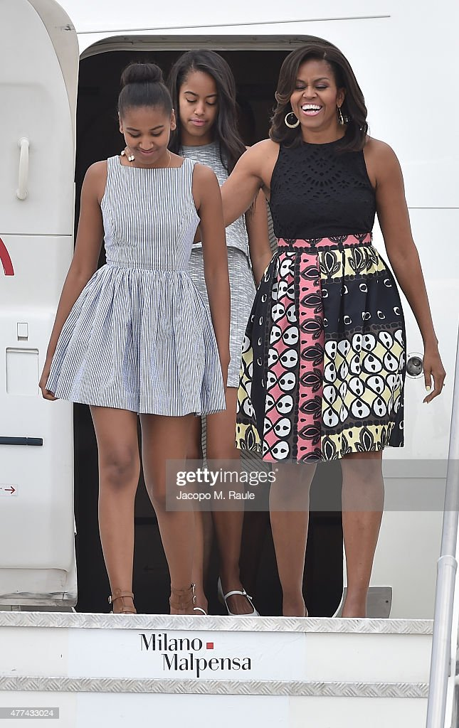 First Lady Michelle Obama arrives with daughters Malia Obama (C) and Sasha Obama (L) at Malpensa Airport on June 17, 2015 in Milan, Italy.
