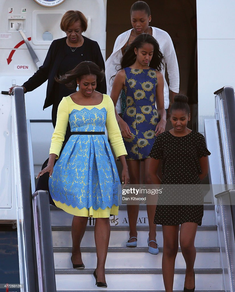 First Lady Michelle Obama arrives with daughters Malia Obama (C) and Sasha Obama (R) and her mother Marian Robinson(behind Michelle) at Stanstead airport on June 15, 2015 in London, England. The First Lady is travelling to London with her daughters, Malia and Sasha and her mother, Mrs. Marian Robinson, to continue a global tour promoting her Let Girls Learn Initiative.  During the visit she will meet with students at a girl's school to discuss how the UK and U.S. are working together to expand girl's education around the world.