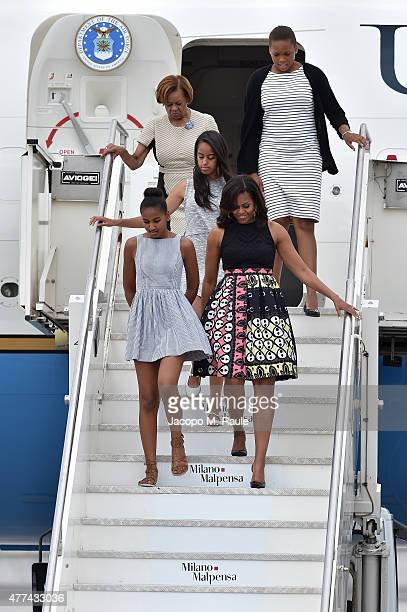 First Lady Michelle Obama arrives with daughters Malia Obama and Sasha Obama and her mother Marian Robinson at Malpensa Airport on June 17 2015 in...