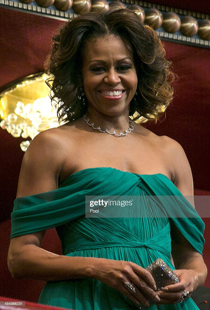 First Lady Michelle Obama attends the 2013 Kennedy Center Honors on December 8, 2013 in Washington, DC. The honorees this year include: opera singer Martina Arroyo, jazz musician Herbie Hancock, musician Billy Joel, actress Shirley MacLaine and musician Carlos Santana.