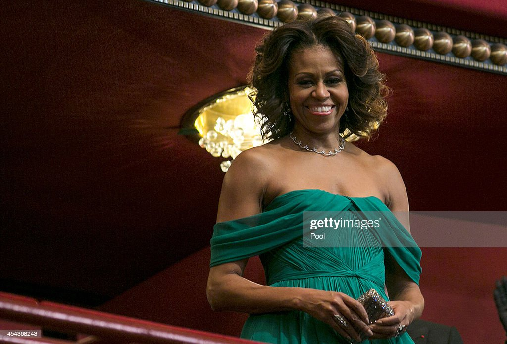 First Lady <a gi-track='captionPersonalityLinkClicked' href=/galleries/search?phrase=Michelle+Obama&family=editorial&specificpeople=2528864 ng-click='$event.stopPropagation()'>Michelle Obama</a> attends the 2013 Kennedy Center Honors on December 8, 2013 in Washington, DC. The honorees this year include: opera singer Martina Arroyo, jazz musician Herbie Hancock, musician Billy Joel, actress Shirley MacLaine and musician Carlos Santana.