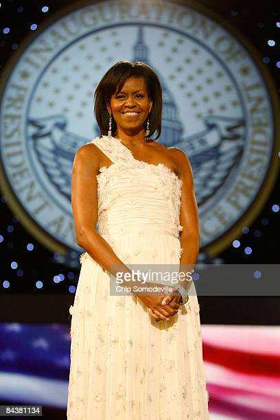 First Lady Michelle Obama attends the Neighborhood Inaugural Ball at the Washington Convention Center on January 20 2009 in Washington DC Obama...