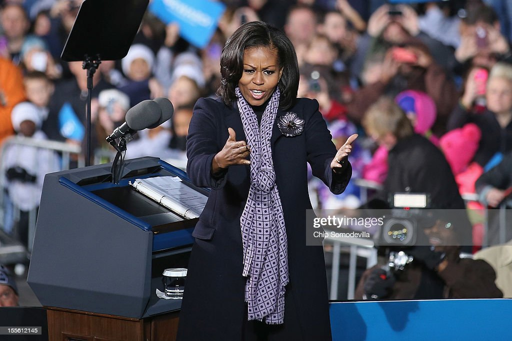 First lady <a gi-track='captionPersonalityLinkClicked' href=/galleries/search?phrase=Michelle+Obama&family=editorial&specificpeople=2528864 ng-click='$event.stopPropagation()'>Michelle Obama</a> blows kisses to suppporters during President Barack Obama's last rally the night before the general election November 5, 2012 in Des Moines, Iowa. The rally was held just outside Obama's first headquarters from the 2008 campaign, where his first march to the White House started. Obama and his opponent, Republican presidential nominee and former Massachusetts Gov. Mitt Romney are stumping from one 'swing state' to the next in a last-minute rush to persuade undecided voters.