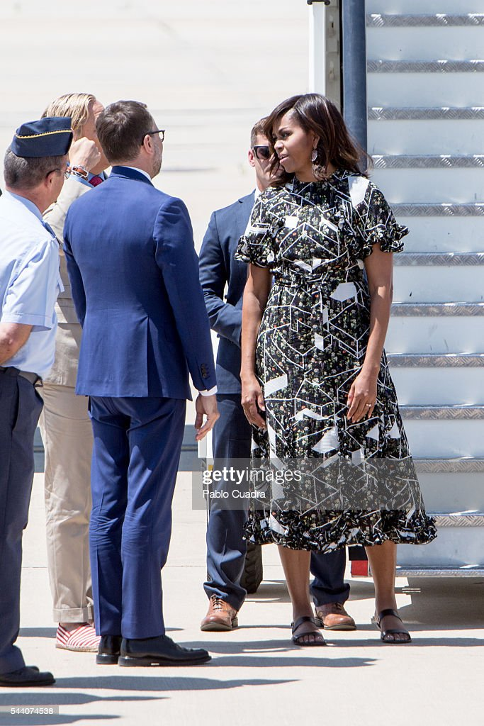 First Lady <a gi-track='captionPersonalityLinkClicked' href=/galleries/search?phrase=Michelle+Obama&family=editorial&specificpeople=2528864 ng-click='$event.stopPropagation()'>Michelle Obama</a> boards an official plane prior to her departure from Torrejon Air Force Base on July 1, 2016. in Madrid, Spain. The First Lady delivered a speech on Let Girls Learn to girls and young women, sharing the stories of girls she has met during her travels and highlighting new commitments to support Let Girls Learn. Mrs. Obama encouraged the audience to value their own educational opportunities, continue to strive for progress for girls and young women in their country, and take action to help the more than 62 million girls around the world who are out of school.
