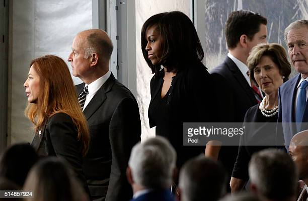 First lady Michelle Obama center arrives with former President George Bush and his wife Laura Bush right and Calif Gov Jerry Brown and his wife Anne...