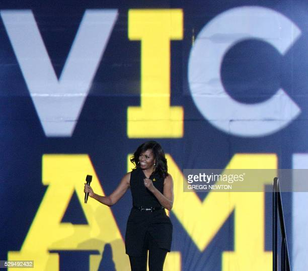 US First Lady Michelle Obama cheers on the wounded soldiers and their loved ones during the opening ceremonies for the 2016 Invictus Games in Orlando...