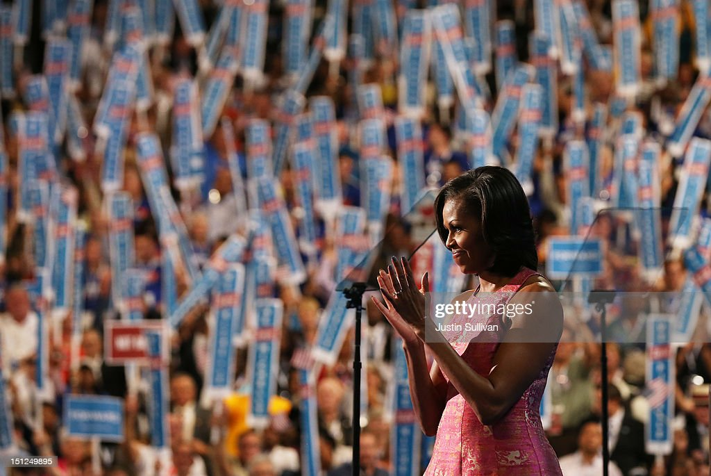 First lady <a gi-track='captionPersonalityLinkClicked' href=/galleries/search?phrase=Michelle+Obama&family=editorial&specificpeople=2528864 ng-click='$event.stopPropagation()'>Michelle Obama</a> claps on stage after speaking during day one of the Democratic National Convention at Time Warner Cable Arena on September 4, 2012 in Charlotte, North Carolina. The DNC that will run through September 7, will nominate U.S. President Barack Obama as the Democratic presidential candidate.