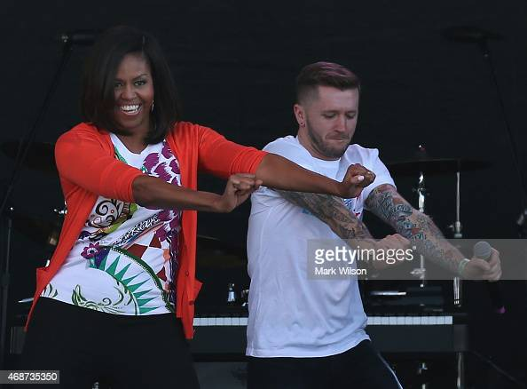 First Lady Michelle Obama dances with members of the All Stars from from the television show 'So You Can Dance' during the annual White House Easter...