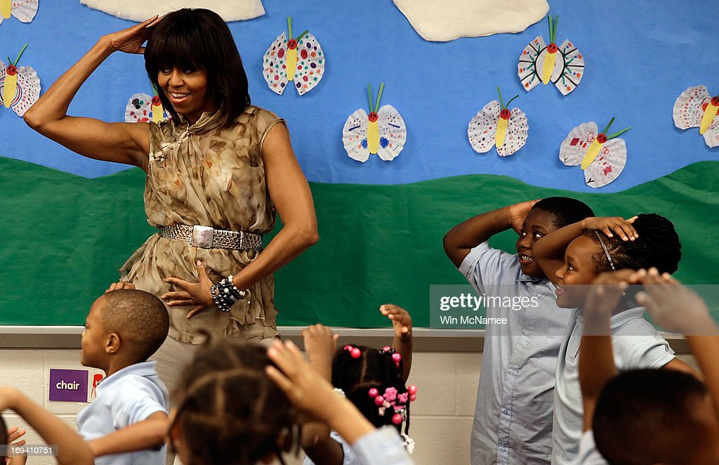 U.S. first lady Michelle Obama dances with pre-kindergarten students while she visits the Savoy School May 24, 2013 in Washington, DC. The Savoy School, once one of the lowest performing schools in the District of Columbia, has shown significant signs of improvement since being designated as one of eight schools selected last year for the Turnaround Arts Initiative by the President's Committee on the Arts and the Humanities.