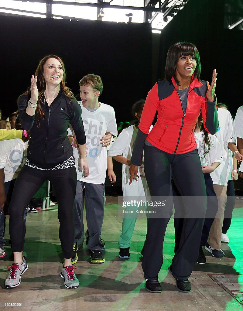 First lady <a gi-track='captionPersonalityLinkClicked' href=/galleries/search?phrase=Michelle+Obama&family=editorial&specificpeople=2528864 ng-click='$event.stopPropagation()'>Michelle Obama</a> (R) dances with school children during a debut of a school exercise program February 28, 2013 in Chicago, Illinois. Obama unveiled a new program called 'Let's Move Active Schools' to help schools create a physical activity programs for students.
