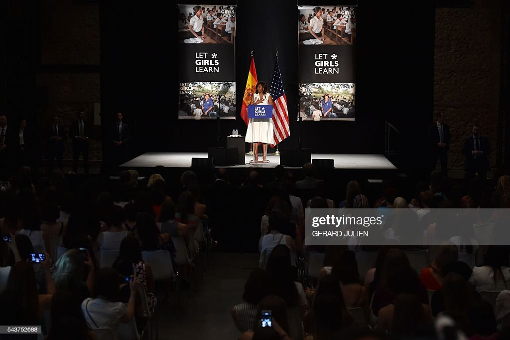 US first lady Michelle Obama delivers a speech presenting the 'Let Girls Learn' initiative on June 29, 2016 in Madrid. First Lady Michelle Obama began a two day visit to Spain by delivering a speech on the education initiative launched in March 2015 to help adolescent girls across the world access a quality education. / AFP / GERARD